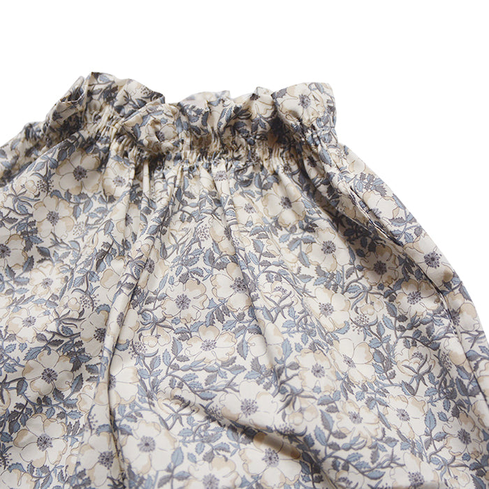 Pull on pants in an all over grey and beige floral print.