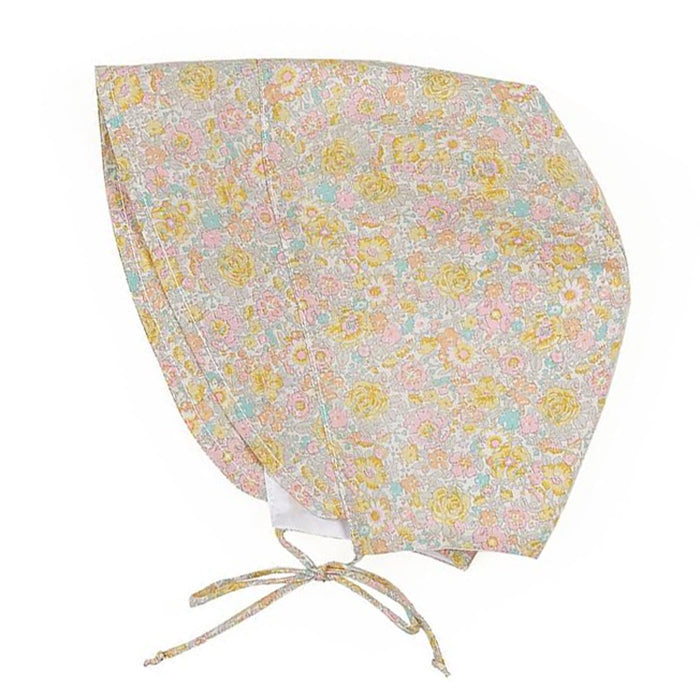 Cotton baby bonnet with ties under the chin and an all over yellow, pink, orange and blue floral print.