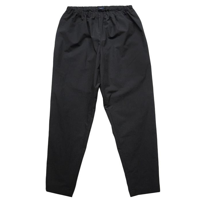 Pull on pants with tapered legs in dark navy blue.