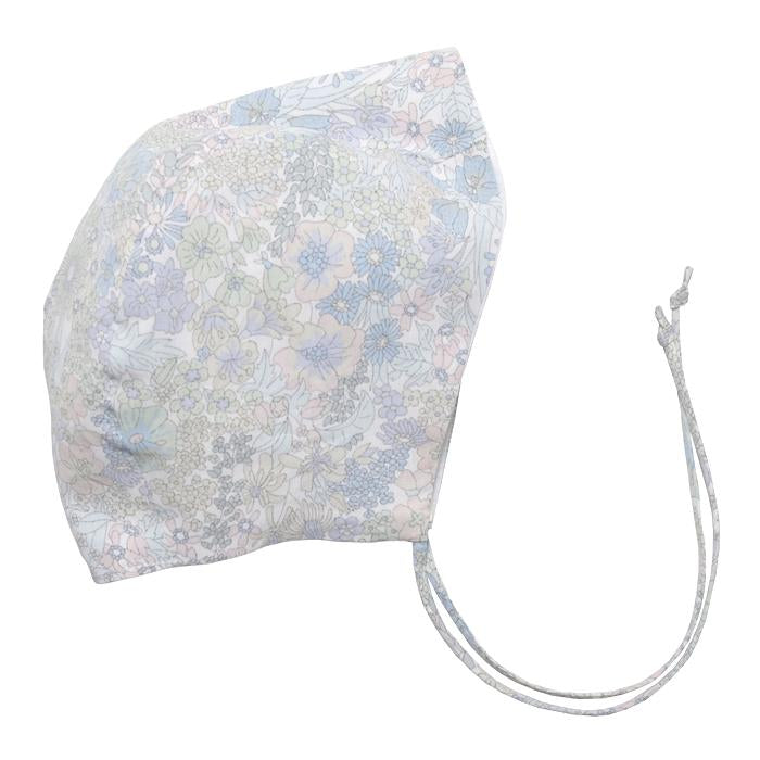 Cotton baby bonnet with ties under the chin and an all over pale green and blue floral print.