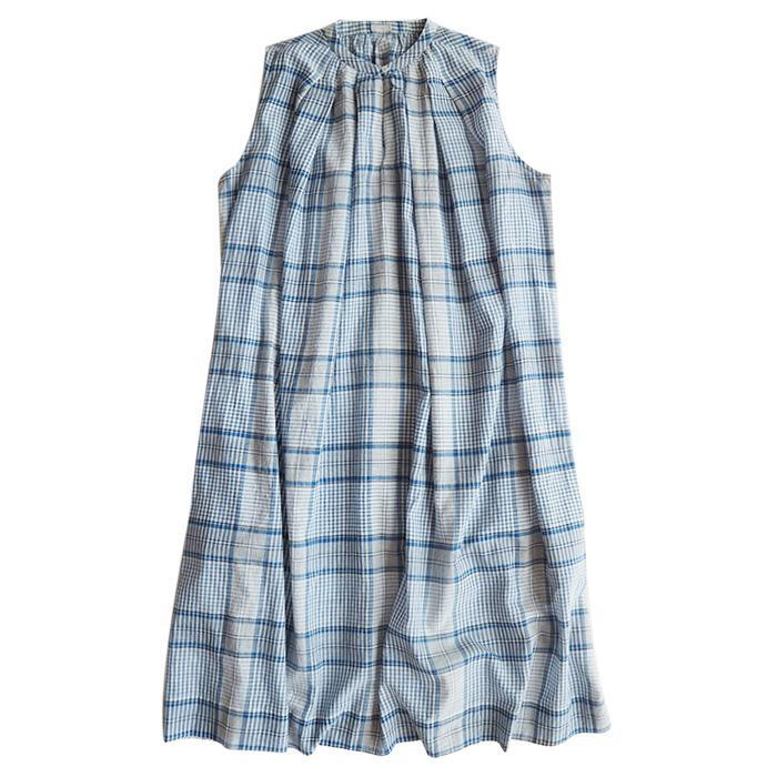 Sleeveless dress in a blue and white plaid fabric.