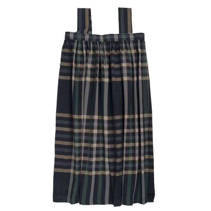 Sleeveless pleated dress with button closure down the side in black with a large beige and green plaid pattern.