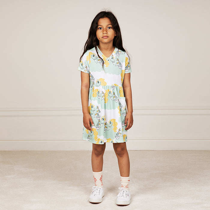 Short sleeved jersey dress in a white, mint green and yellow unicorn eating ramen noodles print.