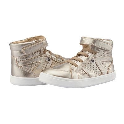 A pair of gold hightop sneakers with a velcro strap across the foot and perforated details.