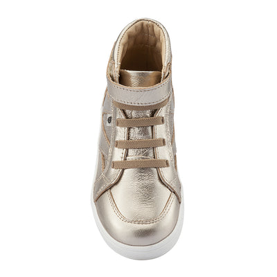 Gold hightop sneakers with a velcro strap across the foot and perforated details from the front.