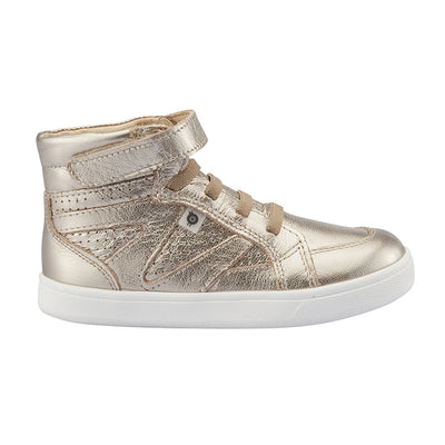 Gold hightop sneakers with a velcro strap across the foot and perforated details from the side.