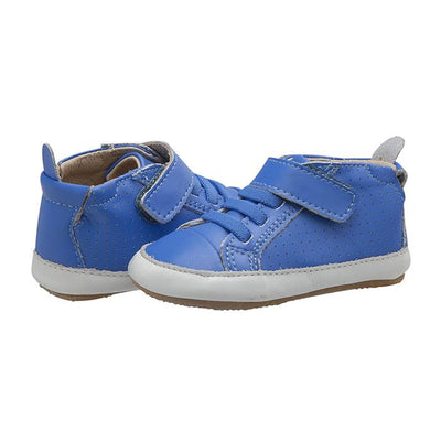 A pair of blue sneakers with soft soles, elastic laces and a velcro strap across the ankle.
