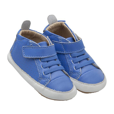 A pair of blue sneakers with soft soles, elastic laces and a velcro strap across the ankle from the side.