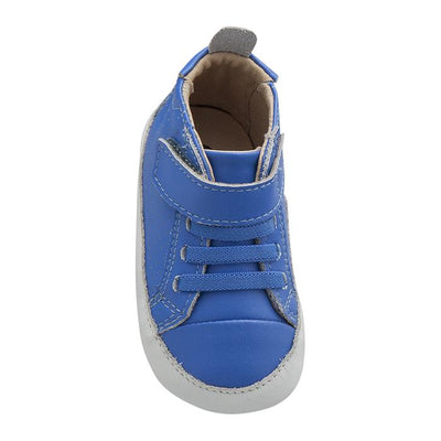 Blue sneakers with soft soles, elastic laces and a velcro strap across the ankle from the front.