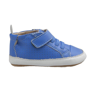 Blue sneakers with soft soles, elastic laces and a velcro strap across the ankle from the side.
