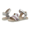 A pair of sandals with white, pink, and silver glitter strap across the foot.