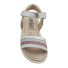 Sandals with white, pink, and silver glitter strap across the foot from the front.