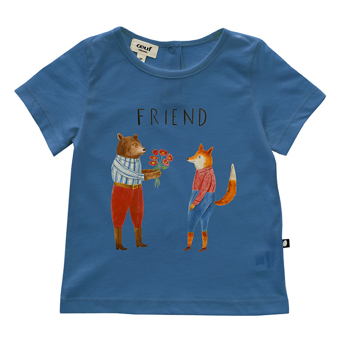 Baby wearing Oeuf's blue short sleeved t-shirt with a cute print on the front of animals in clothes giving each other flowers.