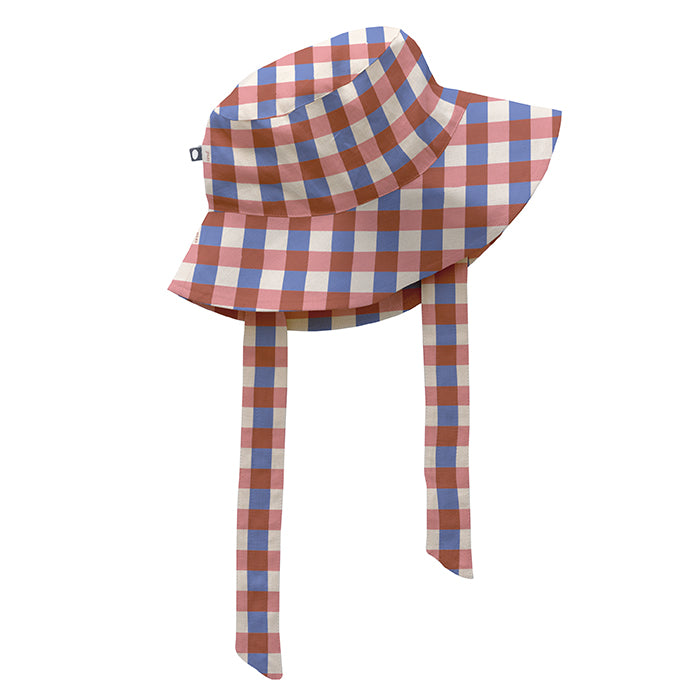 Linen bucket hat with wide tie under the chin in cream, pink, purple and brown gingham pattern.