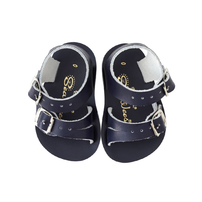 Navy leather sandals with a buckled strap around the ankle and across the foot.