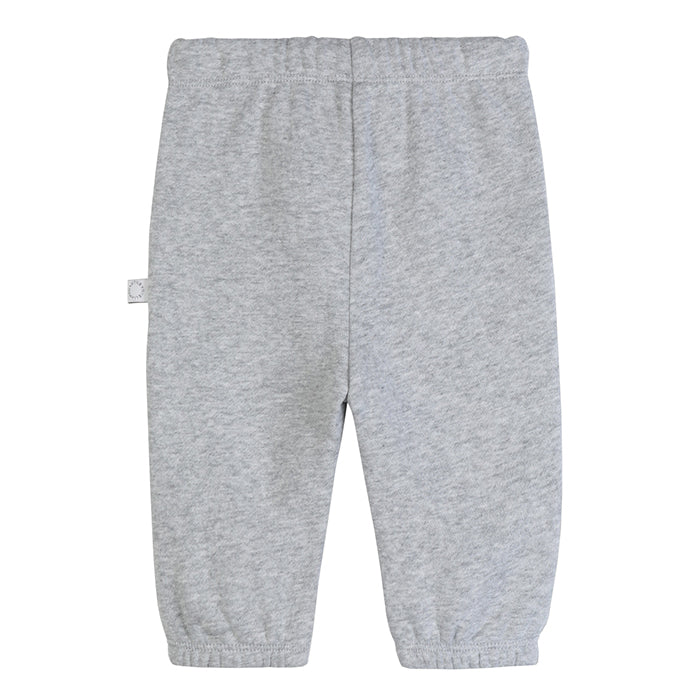 Grey sweatpants with leopard faces on the knees.