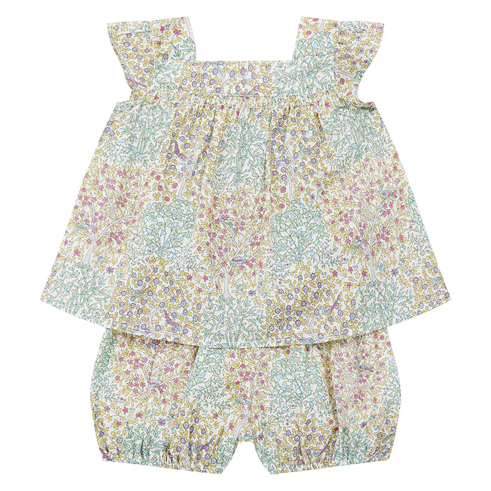 Two piece outfit with a sleeveless blouse and long bloomers in a blue and green floral print.