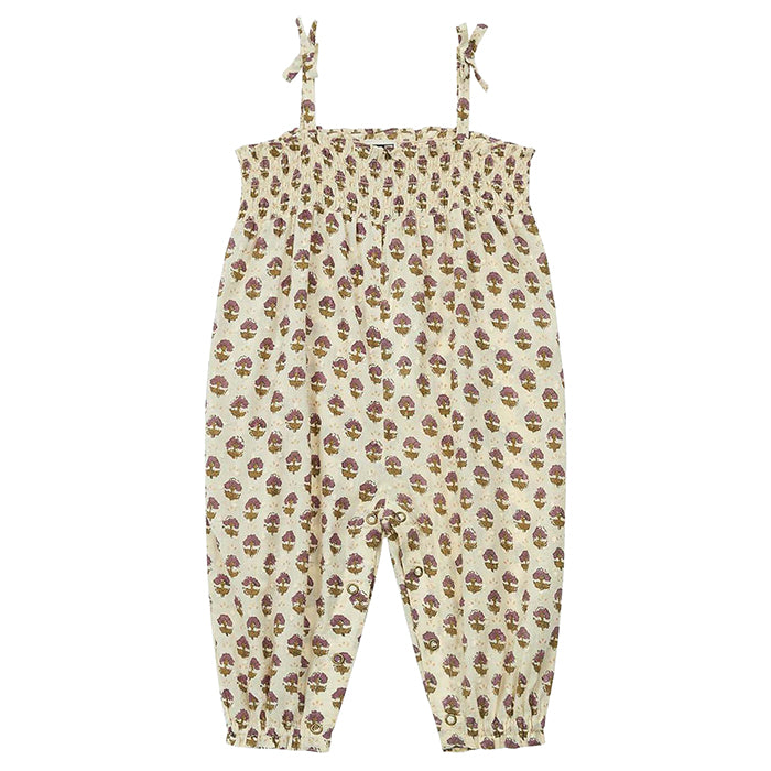 Jumpsuit with smocking around the chest and thin straps that tie at the shoulder in cream with an all over floral print.