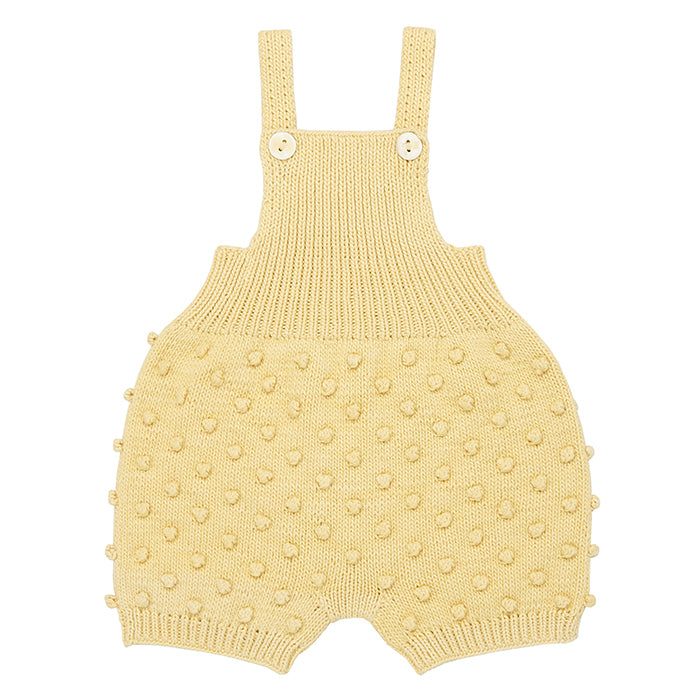 Short overall with a textured knit dot pattern in pale yellow.