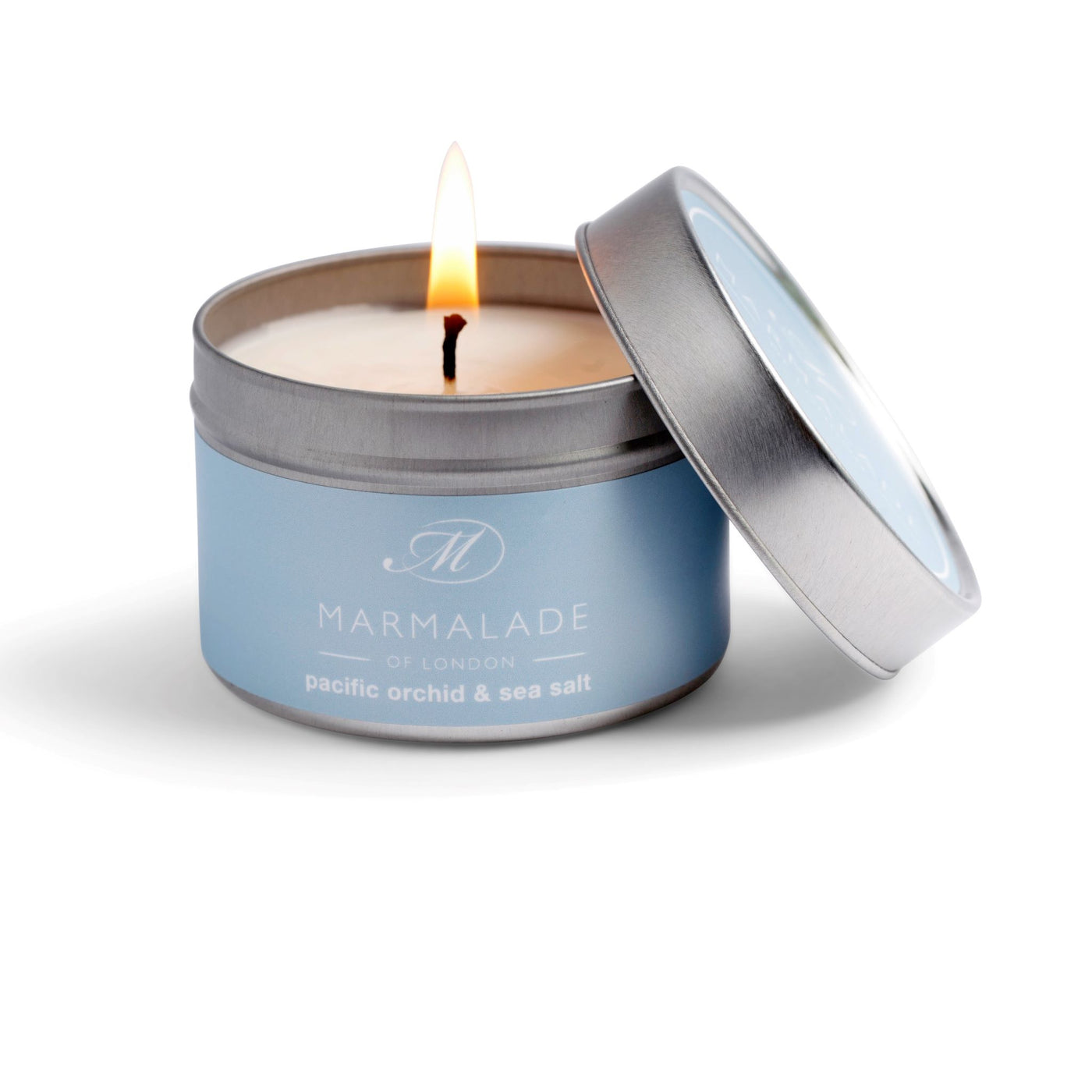 Pacific Orchid and Sea Salt small candle in a pale blue tin with lid.