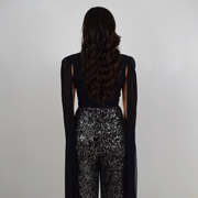 Black and silver jumpsuit with long cape sleeves