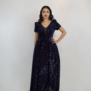 long navy sequin dress with trail