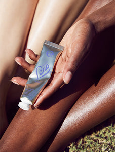 Golden Dry Skin Miracle Salve Tube in Hand with Glossy Legs