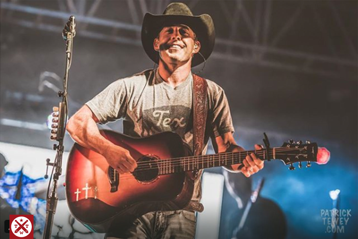 Aaron Watson in concert wearing TWT's Buffalo Tex shirt