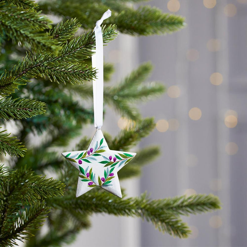 Fairtrade Hand painted Olive Print Star decoration on Christmas tree