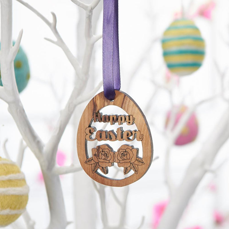 Hand-carved Olive Wood Happy Easter Decoration displayed on Easter tree