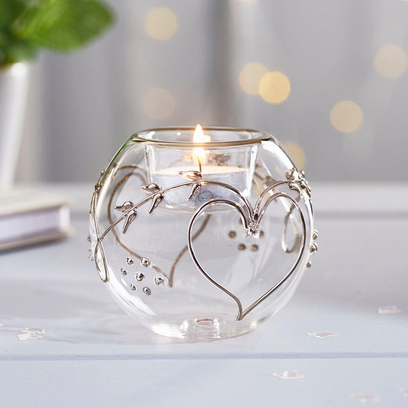 Forever Tealight Holder, shown as a table centrepiece with lit tealight