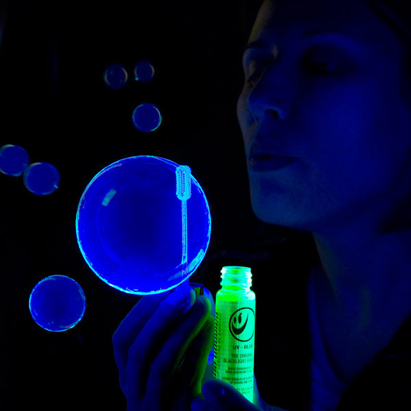 Blowing Tekno Bubbles® under Blacklight