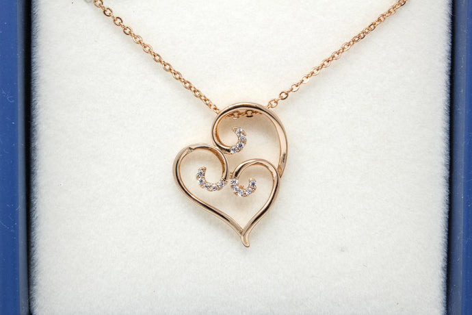 Rose gold swirl heart necklace