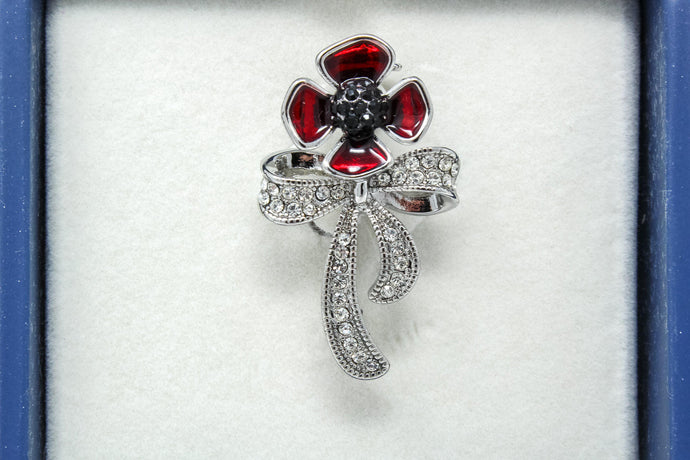 Eq Poppy & diamante bow brooch