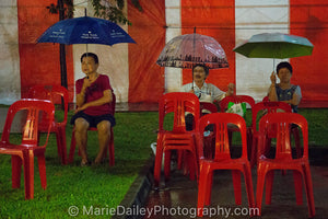 Red Chairs and Umbrellas
