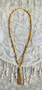 Elegant Beaded Necklace with Golden Tassel