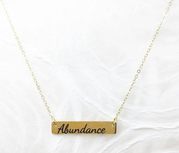 Power of Words: Engraved Goldtone Stainless Steel Necklace (horizontal)
