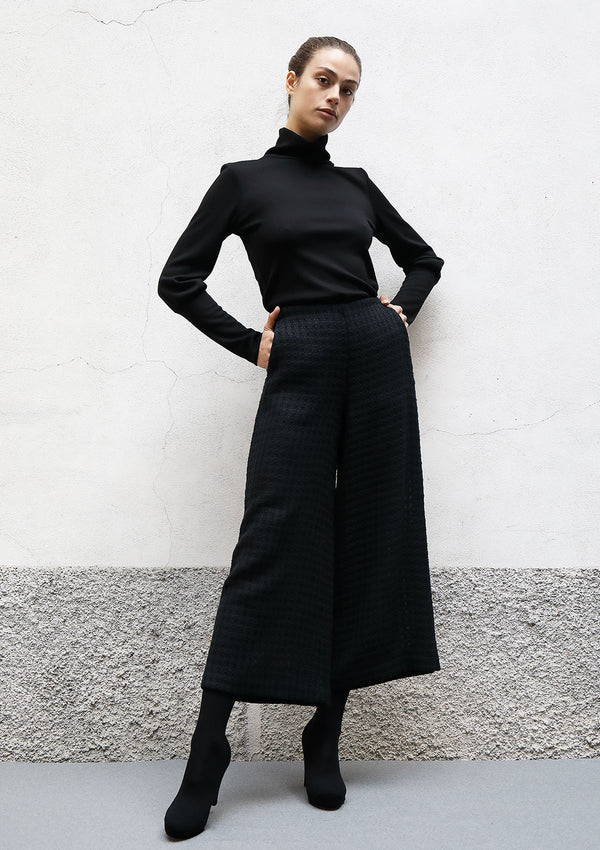 Flared cropped wool trousers