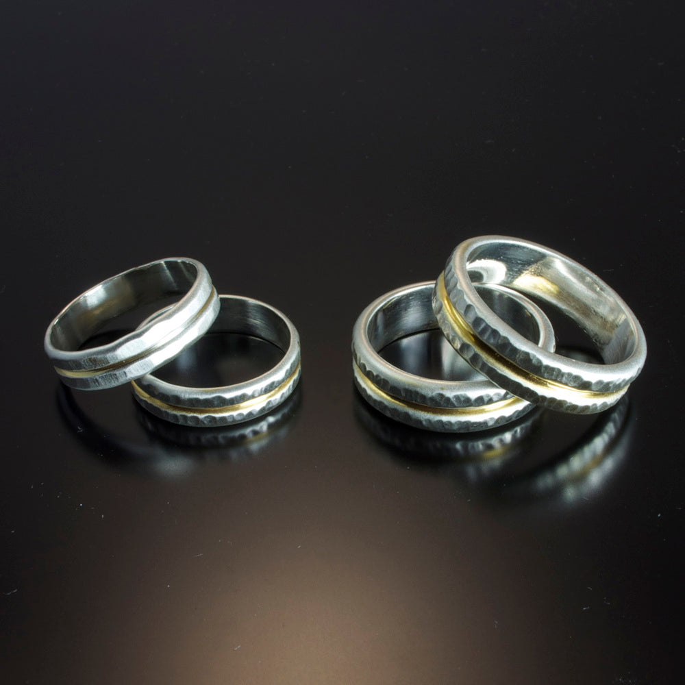 Hammered Sterling Silver bands with 24 Karat gold recess.
