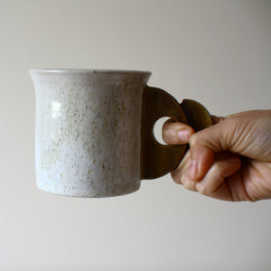 Speckled mug with geometric handle