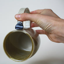 Load image into Gallery viewer, Cream and gold Mug with thumb rest