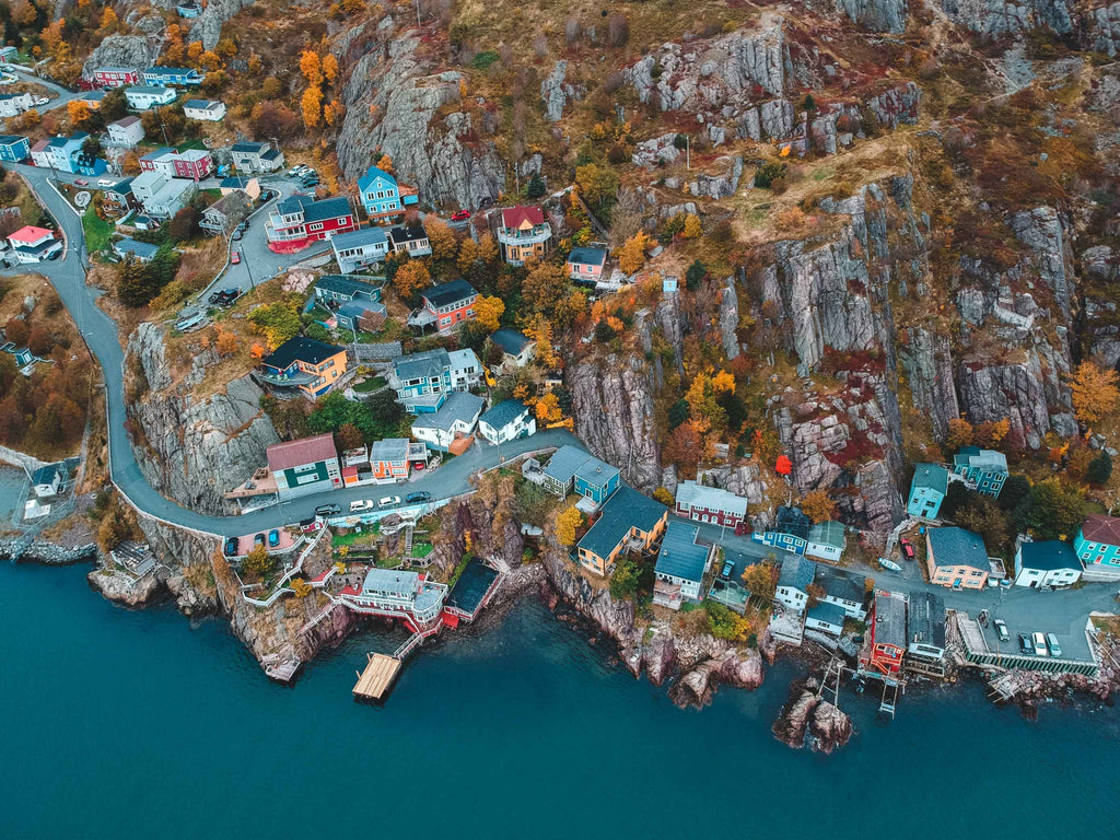 aerial photography of houses and buildings near blue body of water during daytime photo