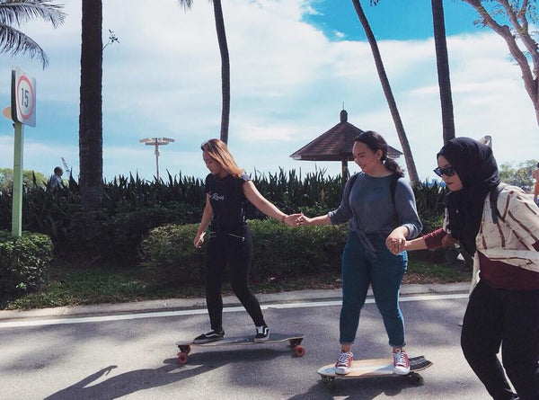longboard girls supporting each other