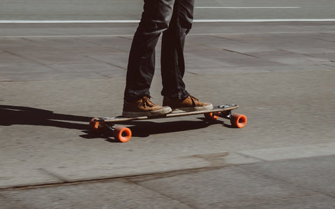Man commuting on longboard