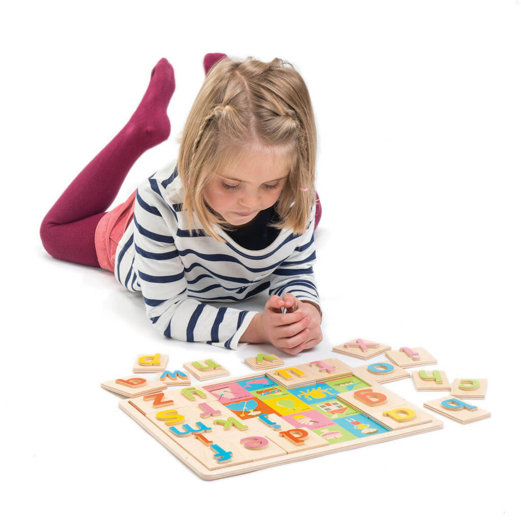 Girl playing with the Tender Leaf Toys Alphabet Pictures