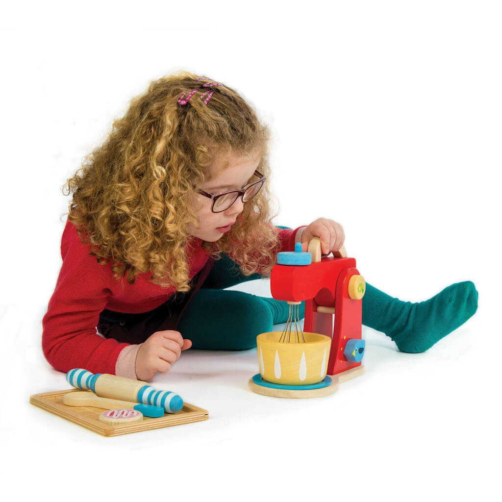 Girl playing with the Tender Leaf Toys Baker's Mixing Set
