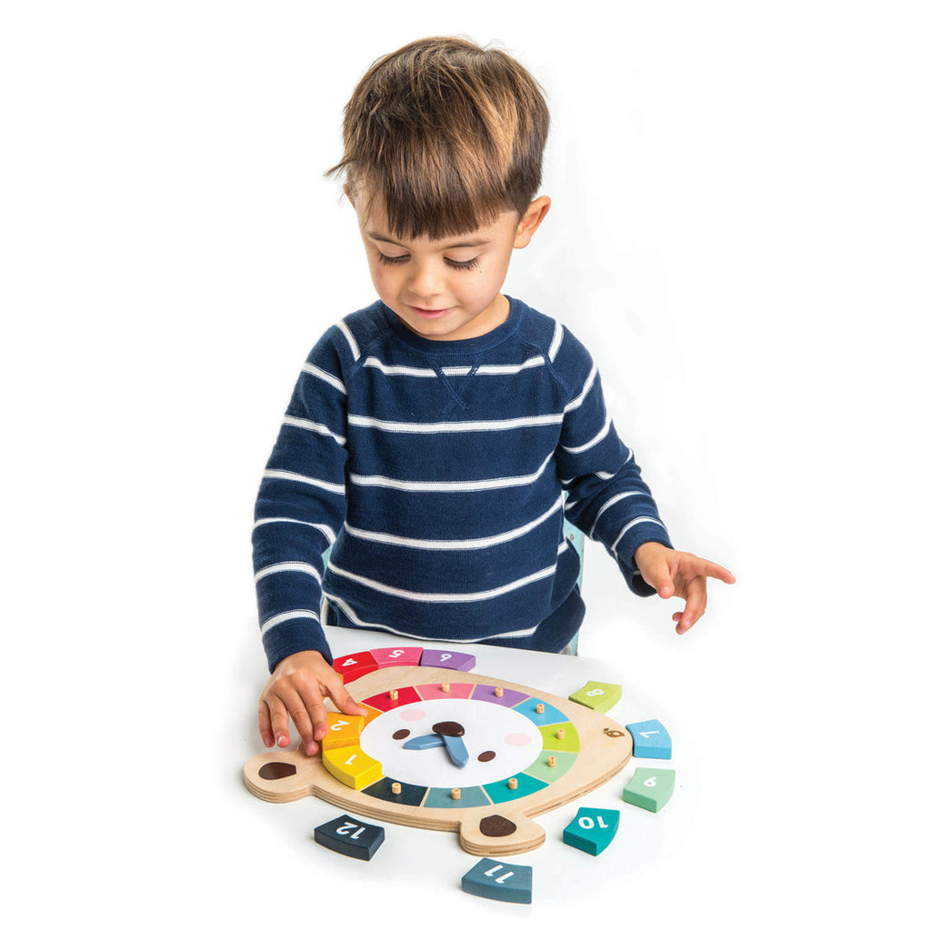 Boy playing with the Tender Leaf Toys Bear Colours Clock