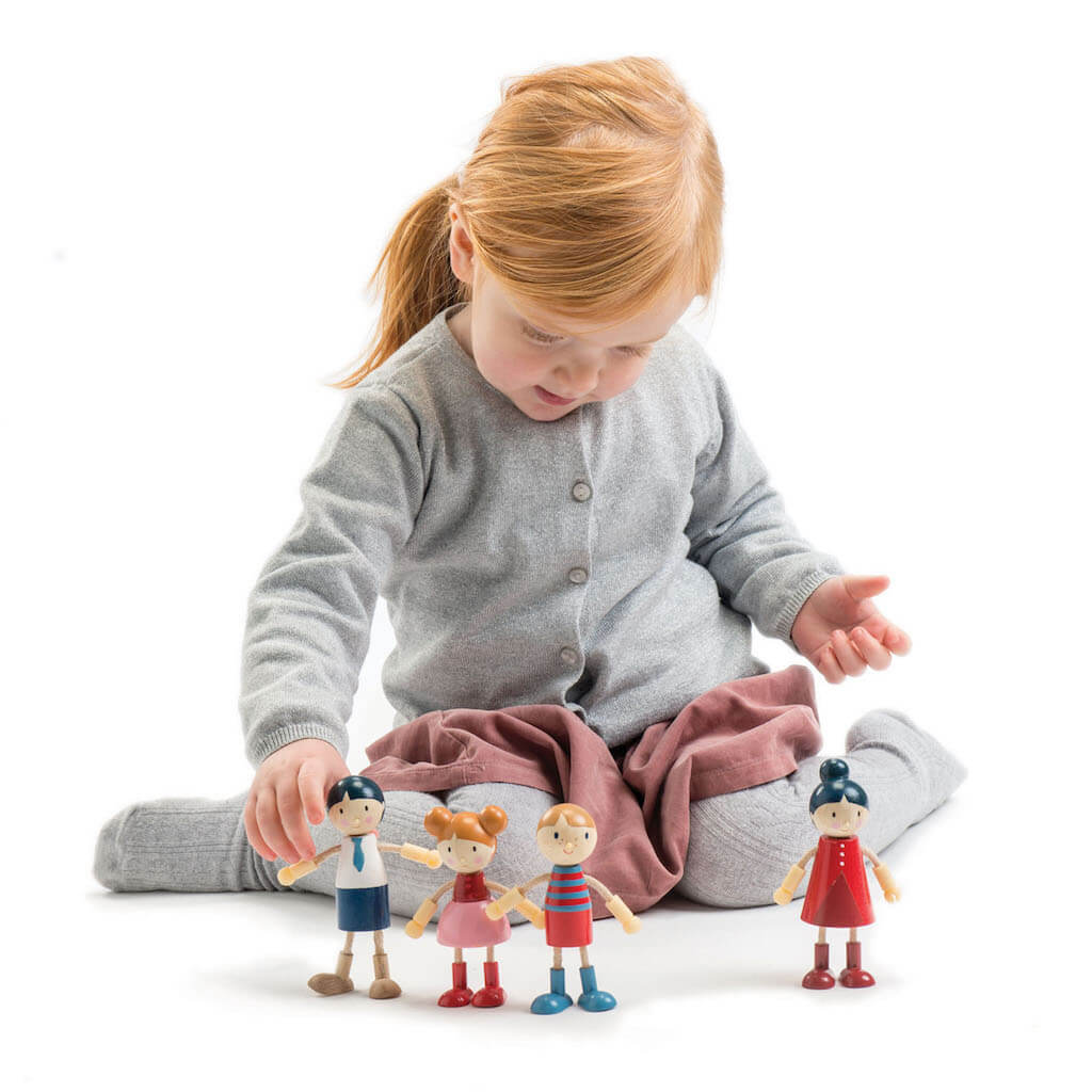 Girl playing with Tender Leaf Toys Doll Family
