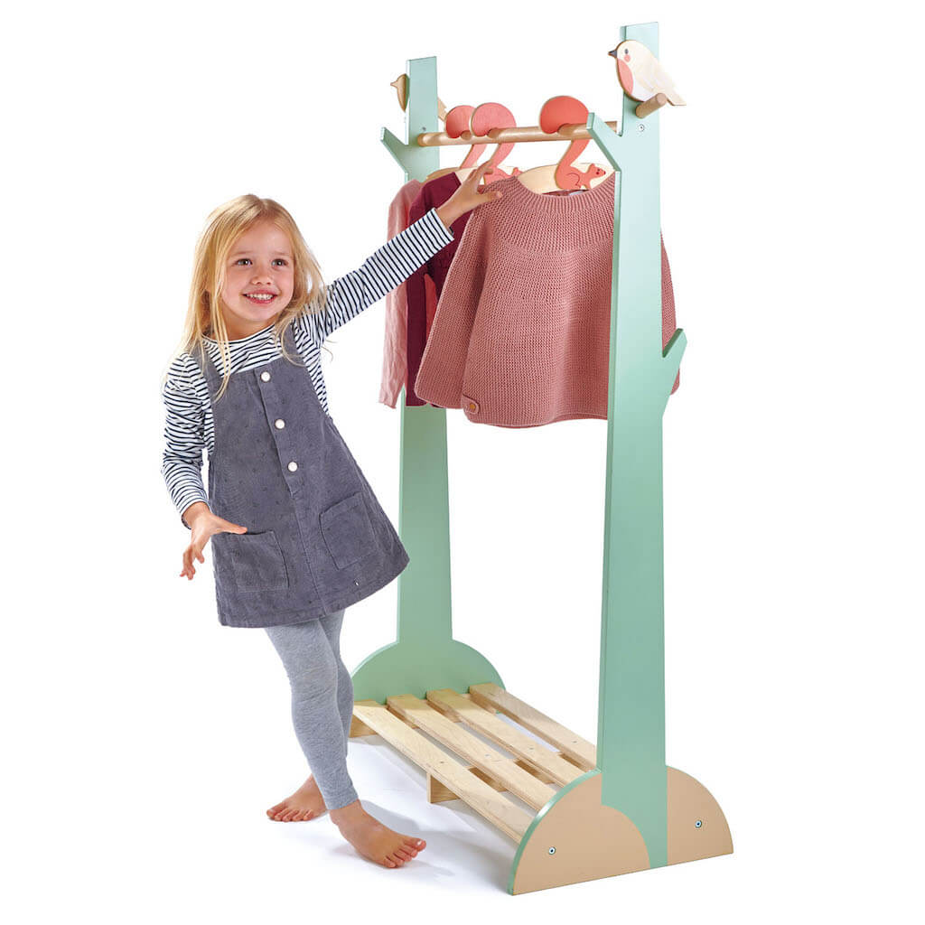 Tender Leaf Toys Forest Clothes Rail with a girl hanging clothes