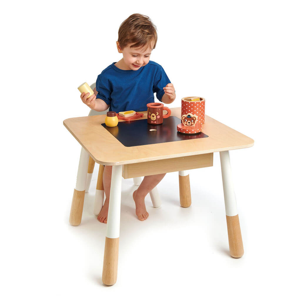 Boy playing on the Tender Leaf Toys Forest Table